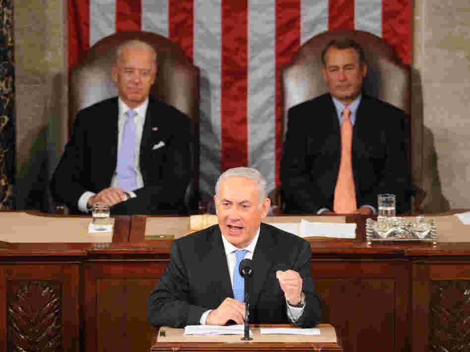 Vice President Joe Biden and House Speaker John Boehner watch as Israeli Prime Minister Benjamin Netanyahu addresses lawmakers at the Capitol on Tuesday.
