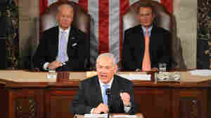 Vice President Joe Biden and House Speaker John Boehner watch as Israeli Prime Minister Benjamin Netanyahu addresses lawmakers at the Capitol on Tuesday.