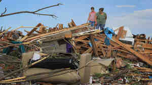 Nine-year-old Maddie Meek (L) and her mother Dina Meek salvaged what they could from a relative's home in Joplin earlier today (May 24, 2011).