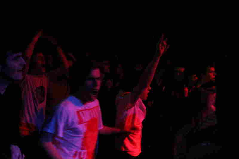 Songs by Black Flag incite the first of the night's many mosh pit moments.