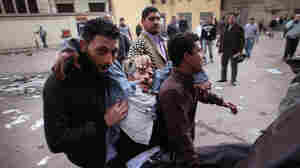Jan. 29, 2011:  Protestors carry an injured man away from Tahrir Square in Cairo, where police had cracked down on demonstrators.