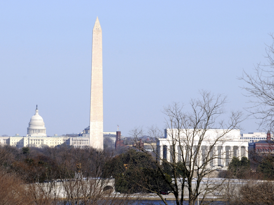 The Capitol Building, Washington Monument, Smithsonian Institution and Lincoln Memorial seen from across the Potomac River. In 2015, The African American History and Culture Museum will come to the Mall, but is being met with controversy. (mikadx/iStock)