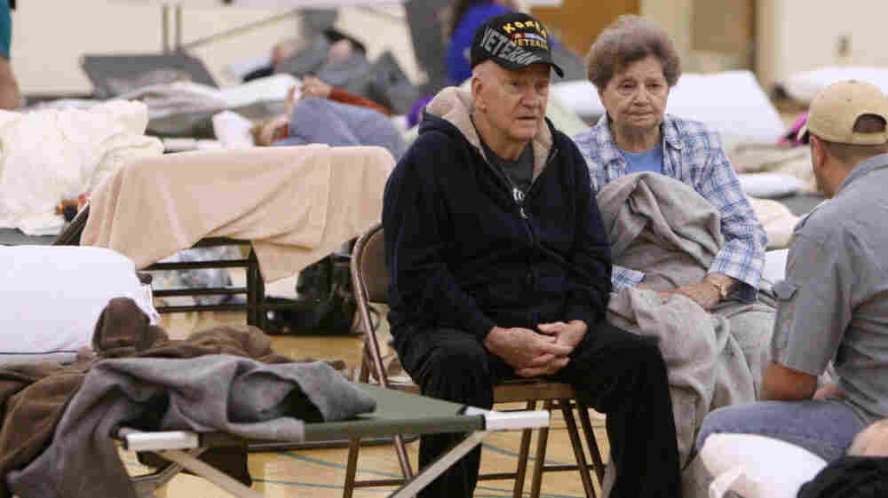Donald and Helen Capps of Joplin, Mo., sit in a temporary Red Cross shelter at the Robert Ellis Young Gymnasium at Missouri Southern State University in Joplin, Mo.