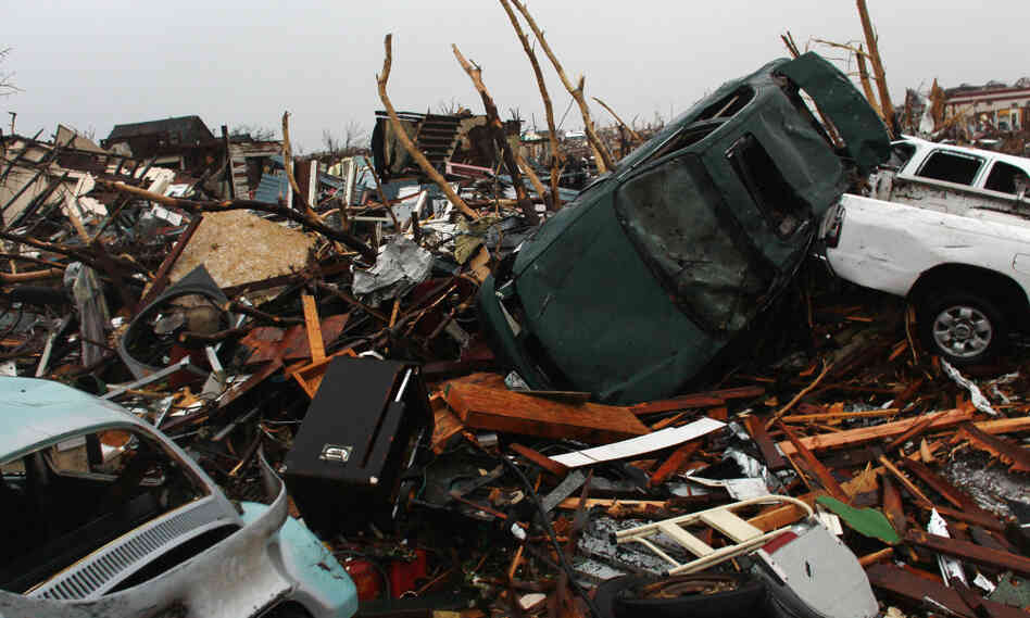 Tornado debris from homes and car