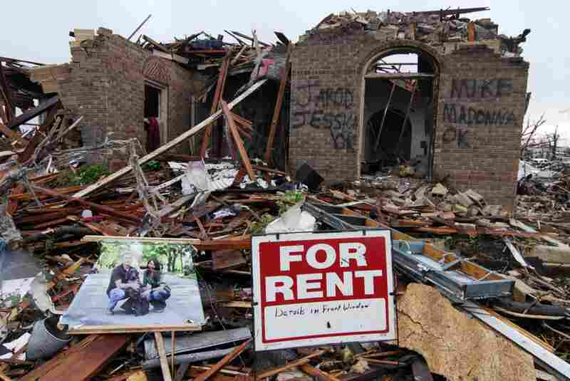 Graffiti informs rescuers that everyone is safe and accounted for at the site of a destroyed home on Monday in Joplin, Mo.