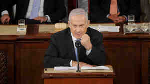 """Israeli Prime Minister Benjamin Netanyahu speaks during a joint meeting of Congress on Tuesday. """"I'm willing to make painful compromises to achieve this historic peace,"""" he said."""