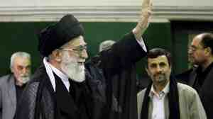 In this photo  released by an official website of the Iranian supreme leader's office, Ayatollah Ali Khamenei waves as President Mahmoud Ahmadinejad stands in the background.