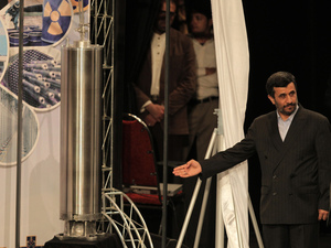 Iranian President Mahmoud Ahmadinejad unveils a sample of the third generation centrifuge for uranium enrichment during a ceremony to mark the National Nuclear Day day in Tehran on April 9, 2010. A report from the International Atomic Energy Agency says production of low enriched uranium at Iran's Natanz facility is on the rise.
