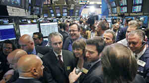 LinkedIn CEO Jeff Weiner, center right with beard, and Reid Hoffman, center background with glasses, listen to traders during their company's listing on May 19 on the New York Stock Exchange. The company reached a market value of $9 billion last week, leading to fears of another dot-com bubble.