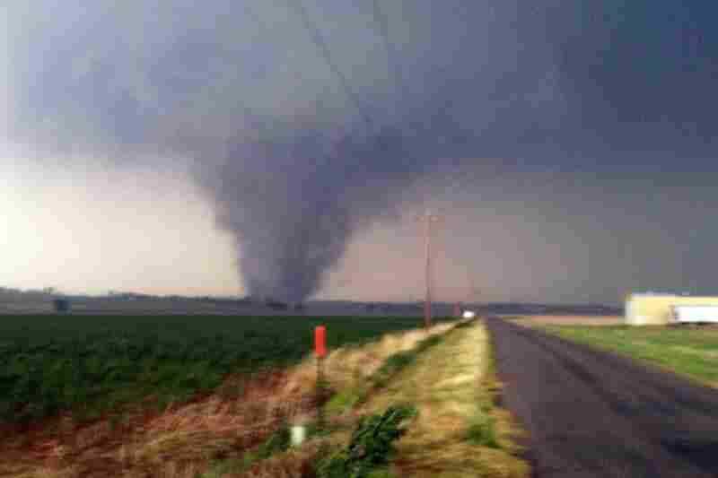 A tornado touches down near Chickasha, Okla., on Tuesday. A line of violent thunderstorms roared across middle America on Tuesday, killing several people.