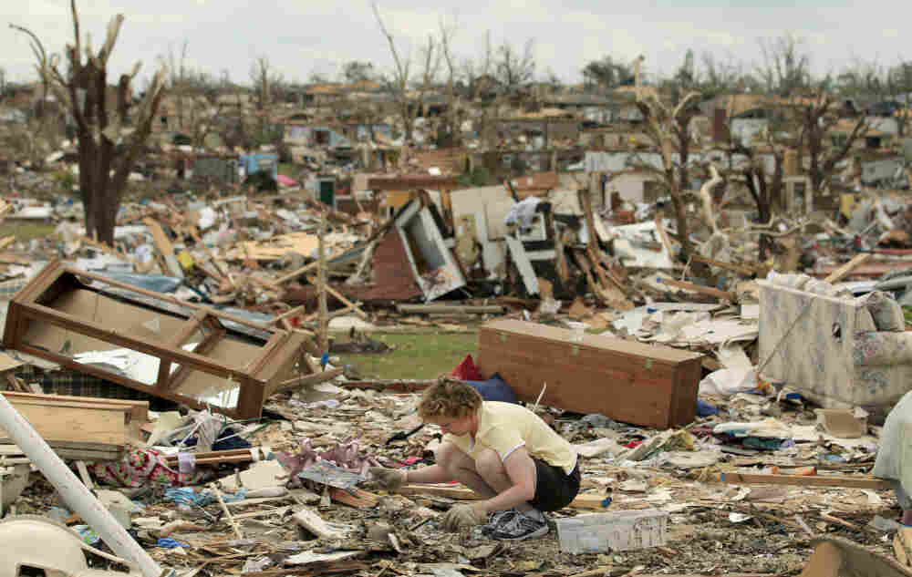 Debbie Surlin salvages items from her parent's home in Joplin, Mo. The tornado that struck Joplin on Sunday killed at least 125 people.