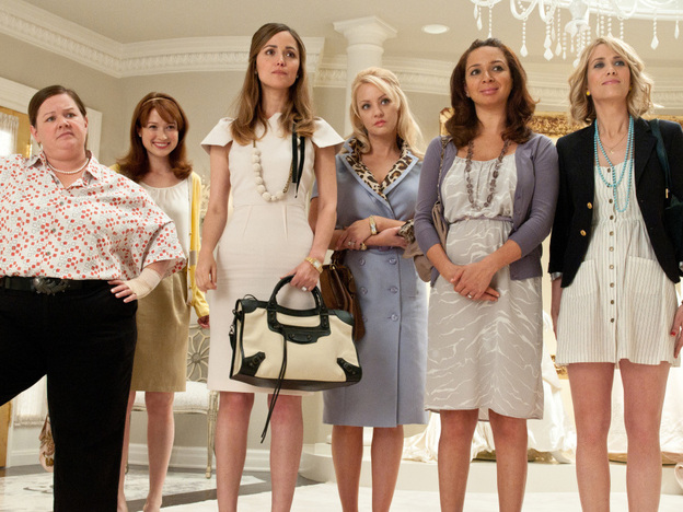 The cast of Paul Feig's <em>Bridesmaids</em>: Melissa McCarthy (from left), Ellie Kemper, Rose Byrne, Wendi McLendon-Covey, Maya Rudolph and co-writer Kristen Wiig.