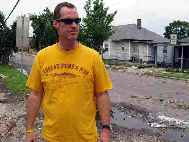 Thomas Herrod inspects roof damage in Joplin.