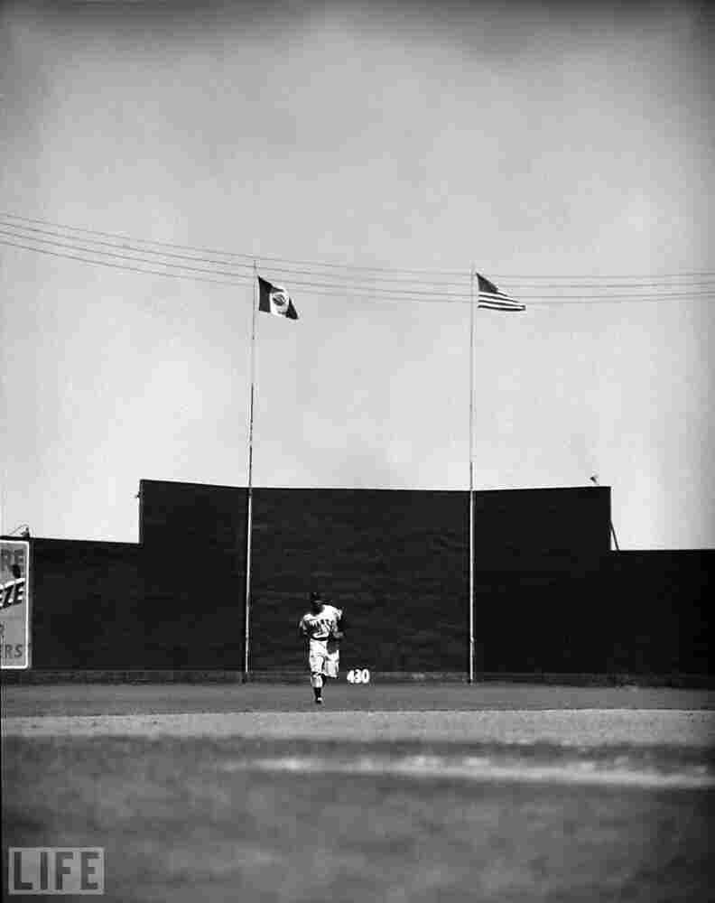 Mays jogs in from center field, 1954