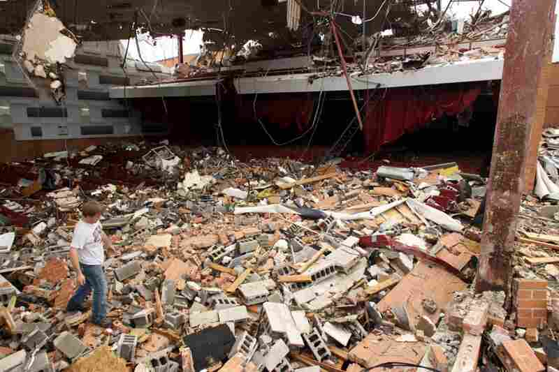 Joplin High School sophomore Landan Taylor makes his way across the wreckage of the school's theater in Joplin, Mo., on Tuesday.