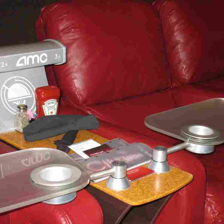 The new addition to the AMC Mainstreet movie theater in Kansas City, Mo. — dinner-ready recliners, complete with tray table and condiments.