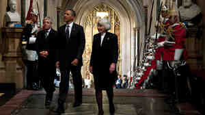 President Obama, accompanied by Commons Speaker John Bercow and Lords Speaker Baroness Helen Hayman, as he entered Westminster Hall.