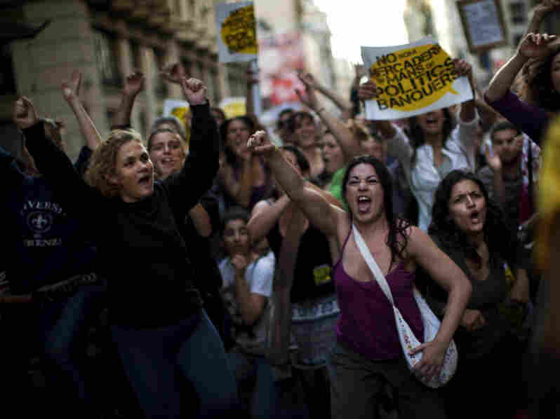 "Demonstrators shout slogans as they protest during a rally called ""Real Democracy Now"" in Barcelona. Demonstrations have taken place in cities across Spain."