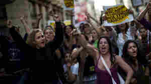 """Demonstrators shout slogans as they protest during a rally called """"Real Democracy Now"""" in Barcelona. Demonstrations have taken place in cities across Spain."""
