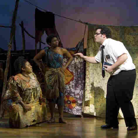 Preaching It: Ugandan villagers in The Book of Mormon (from left), Michael James Scott, Asmeret Ghebremichael, Rema Webb, Lawrence Stallings, Mala Nkenge Wilson and Darlesia Cearcy listen to missionary Josh Gad.