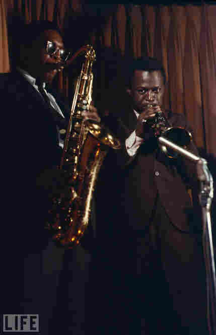 John Coltrane (left) and Miles Davis.