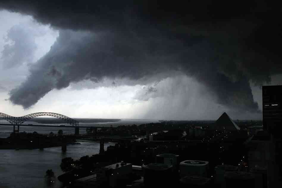 A line of severe storms crosses the Mississippi River in Memphis, Tenn., on Wednesday. The dark formation was reported a few minutes earlier as a tornado in West Memphis, Ark.