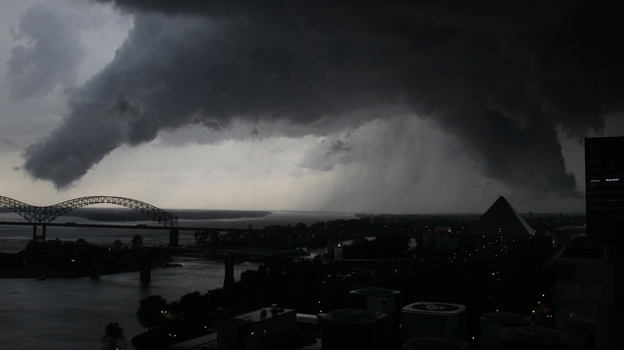 A line of severe storms crosses the Mississippi River in Memphis, Tenn., passing by the Memphis Pyramid on Wednesday. The dark formation was reported a few minutes earlier as a tornado in West Memphis, Ark.