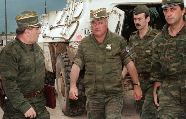 Gen. Ratko Mladic (center), commander of the Serbian forces in Bosnia, arrives at Sarajevo's airport Aug. 10, 1993.
