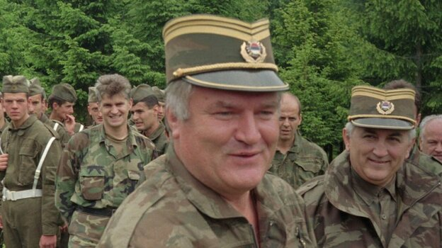 Bosnian Serb military commander General Ratko Mladic visits troops in June, 1996.