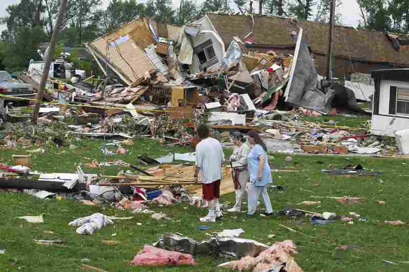 Residents examine the damage from a severe storm that hit a trailer park in Bloomington, Ind., on Thursday.