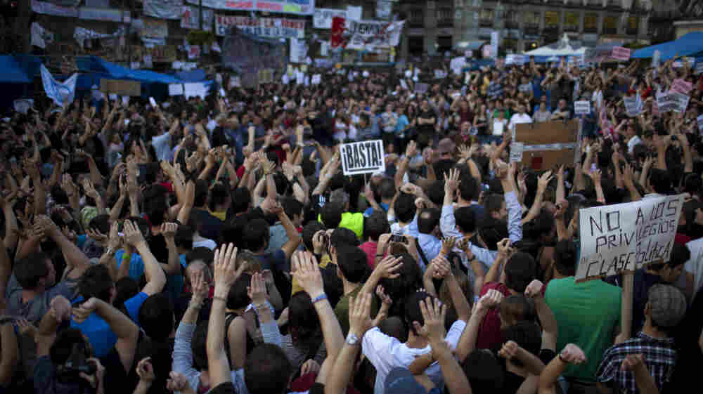 Demonstrators raise their hands as they shout slogans during a protest in Madrid on May 20. Spanish university students and youth groups are protesting a high youth unemployment rate and austerity measures taken to end Spain's debt crisis.