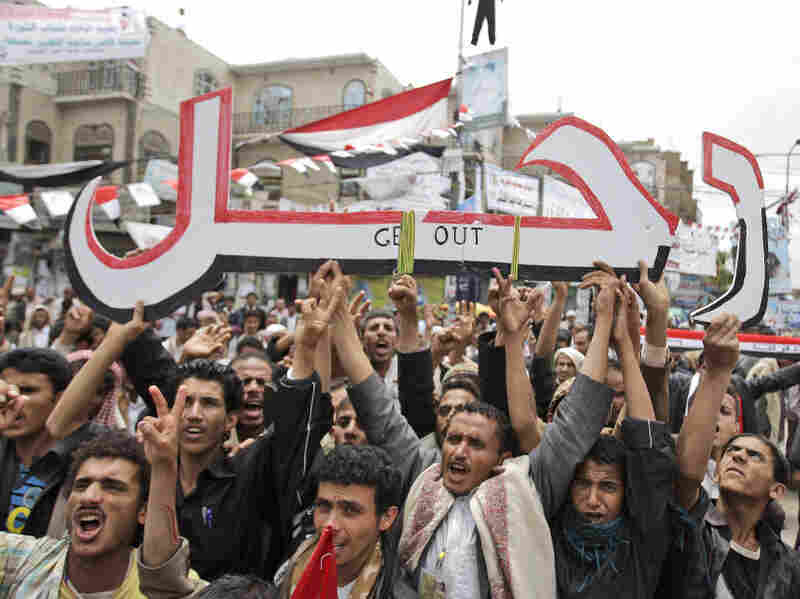 "Anti-government protesters hold up a placard that reads ""Leave"" in Arabic during a demonstration demanding the resignation of President Ali Abdullah Saleh in Sanaa, Yemen, on Thursday."
