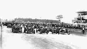 Forty cars lined up for the start of the inaugural Indianapolis 500 in 1911.
