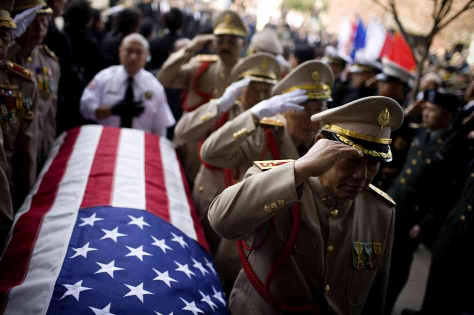 Military officials salute the casket of Gen. Vang Pao during his funeral procession in Fresno, Calif., on Feb. 4. In the 1
