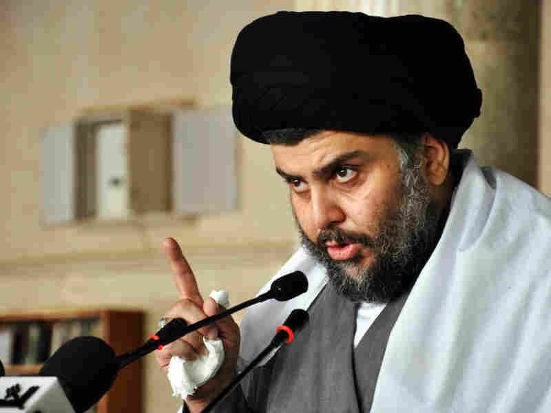 Al-Sadr speaks at Friday prayers in Kufa, Iraq, earlier this month.