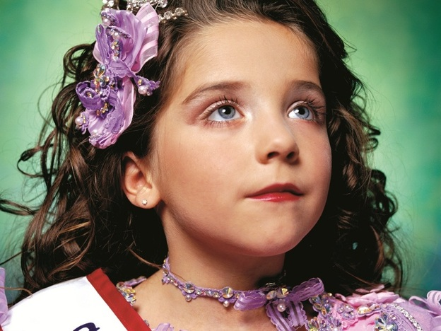 "New York-based artist Andres Serrano's <em>America</em><em> (Jewel-Joy Stevens, America's Little Yankee Miss)</em> is one of many works included in ""America: Now and Here."""