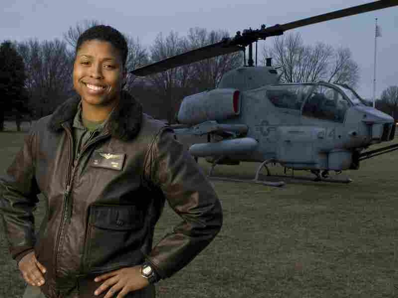 Vernice 'Flygirl' Armour, the first African American female combat pilot, stands in front of a helicopter.
