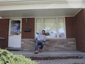 Brian Gillespie in front of his home.