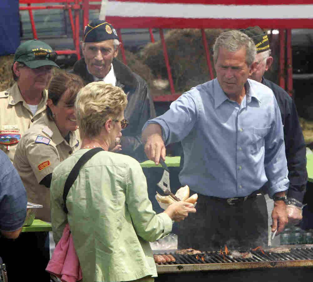 President Bush mans the grill during a campaign stop at Bittersweet Farm in Stratham, N.H., Aug. 2004.