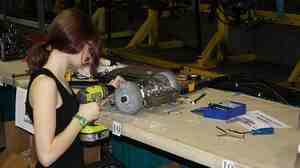 A student works on her robot gladiator.