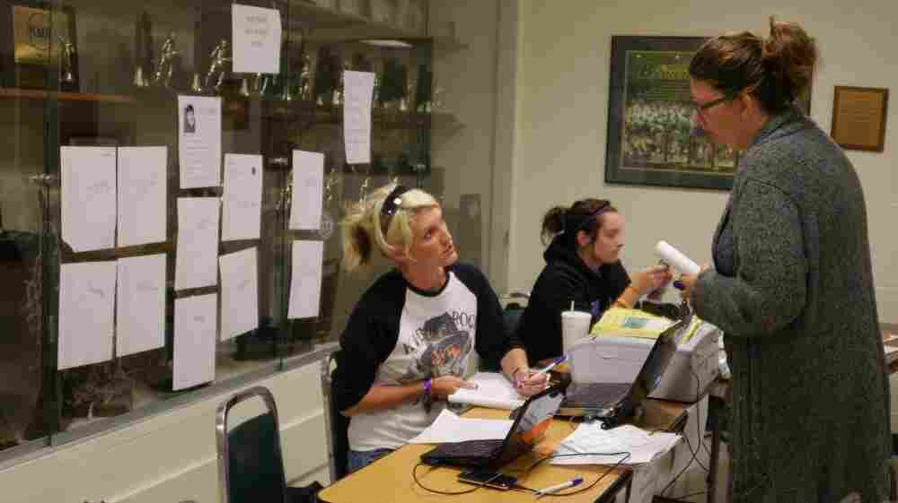 Red Cross volunteer Shana Holman helps a woman search for a missing loved one in Joplin.