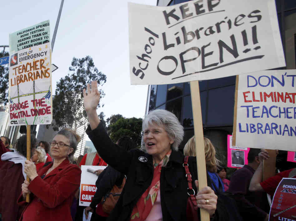 Teachers and librarians demonstrate against thousands of proposed job cuts in the Los Angeles Unified School District Tuesday.