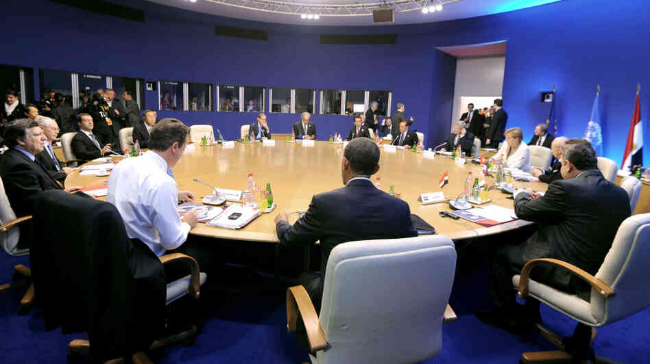 President Obama (center, back to camera) and leaders earlier today at the G8 summit in Deauville, France.