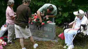 Edna Ledford Proctor, seated, and family decorate Ledford graves, Cochran Cemetery, Swain Co., NC, June 2, 2007. In today's second hour, host Neal Conan will talk with listeners about how they remember on Memorial Day.