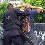 """Members of the Salvadoran police squad """"The Hawks"""" search suspected gang members in San Salvador."""