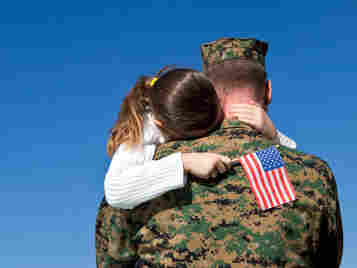 A child hugs a member of the military. Monday is Memorial Day, a day meant to honor and thank the U.S. troops everywhere.