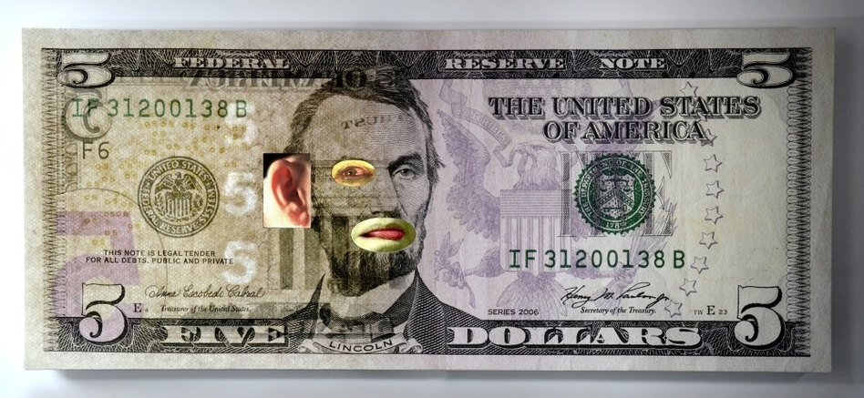 In Tony Oursler's <em>$5,</em> video elements show through holes in a $5 bill, making it look like Abraham Lincoln's eye and mouth are moving.