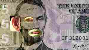In Tony Oursler's $5, video elements show through holes in a $5 bill, making it look like Abraham Lincoln's eye and mouth are moving.