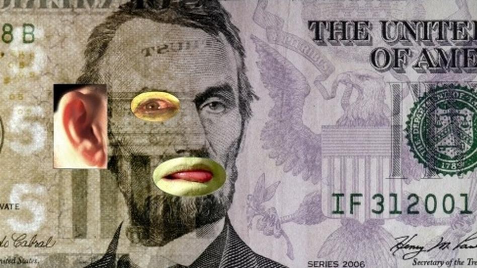 In Tony Oursler's $5, video elements show through holes in a $5 bill, making it look like Abraham Lincoln's eye and mouth are moving. (Courtesy of America: Now and Here)