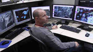Mark Darrow, a meteorologist at the National Weather Service's Storm Prediction Center in Norman, Okla., keeps watch by looking for evidence of tornadoes, heavy winds and damaging hail.